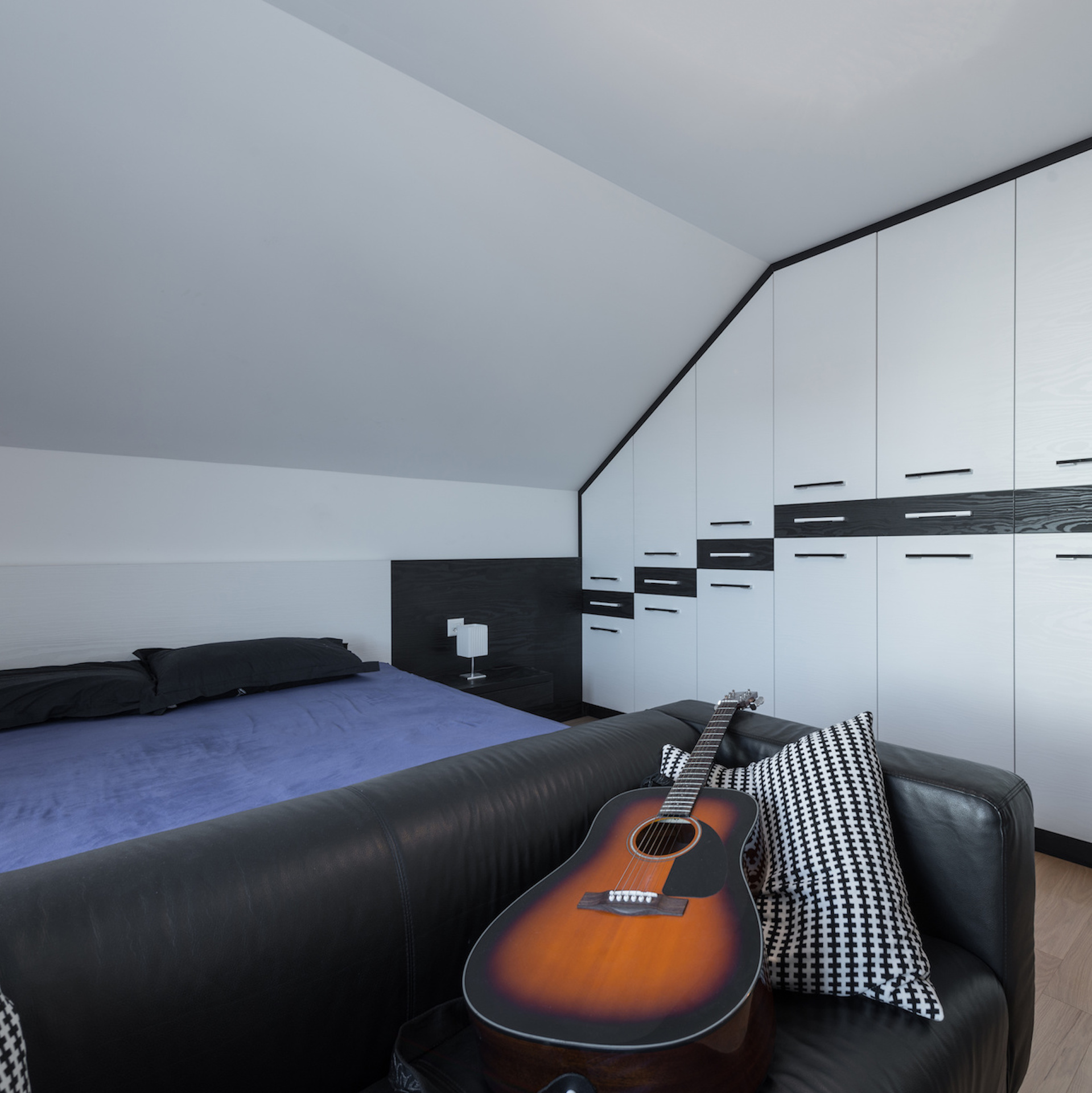 Converting an attic sky-blue-lofts-south-wales-loft-conversion-company-cardiff-attic-modification-penarth-barry-lisvane-fairwater-ely-roath-canton-caerphilly-bridgend-valleys-Master bedroom and dresser in attic interior